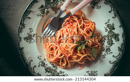 Spaghetti pasta with tomato sauce, mussels and cheese parmesan. Toned picture - stock photo
