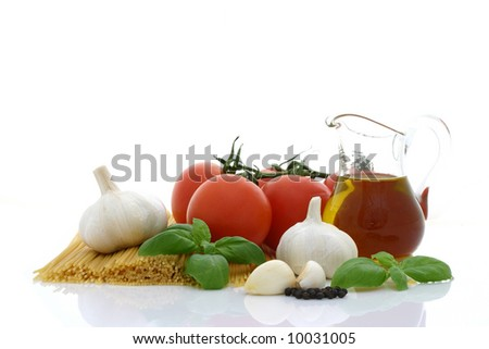 Spaghetti preparation: tomatoes, olive oil, garlic and basil - stock photo