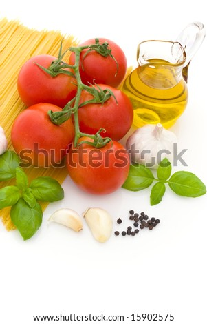 Spaghetti preparation: tomatoes, olive oil, garlic and basil