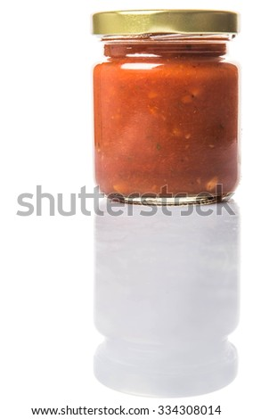 Spaghetti sauce in a mason jar over white background