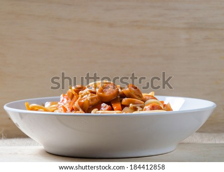Spaghetti sausage mushroom and carrot - stock photo