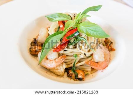 spaghetti seafood in white dish,Thai style. - stock photo