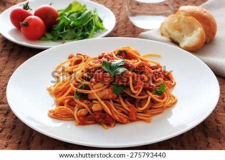 spaghetti tomatosauce with chicken  ragu - stock photo