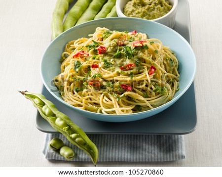 spaghetti with bean broad sauce and hot chili pepper - stock photo