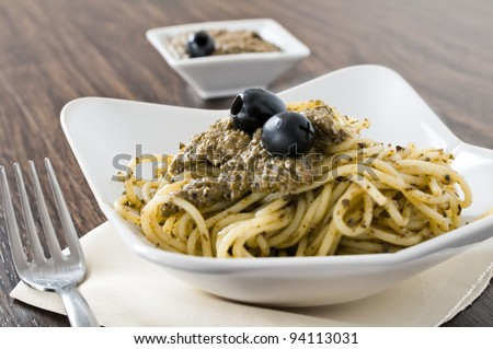 Spaghetti with black olive pesto. - stock photo
