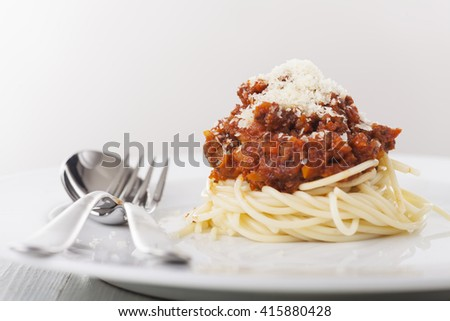 spaghetti with bolognes on a plate  - stock photo