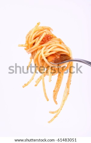 Spaghetti with bolognese sauce hanging on a fork - stock photo