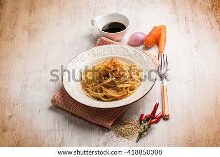 spaghetti with carrot soy sauce and sesame seed - stock photo