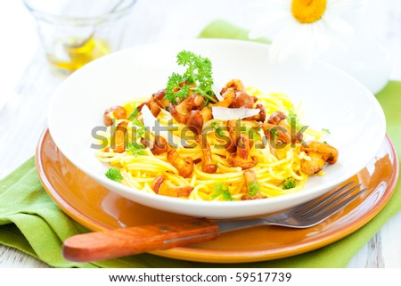 spaghetti  with chanterelles,parsley and grated parmesan - stock photo