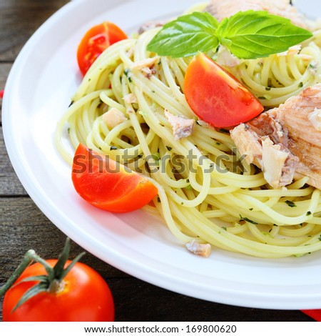 spaghetti with fish and vegetables, food closeup