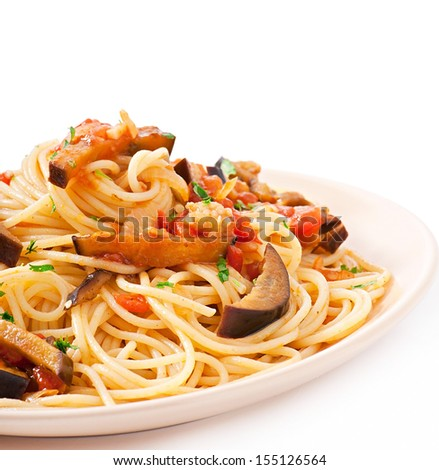 spaghetti with fried eggplant and tomatoes and sweet and sour sauce - stock photo