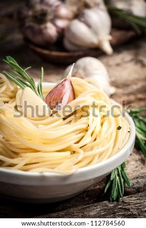 spaghetti with garlic and rosemary. Organic food - stock photo