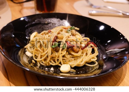 Spaghetti with ham and pepper in restaurant.