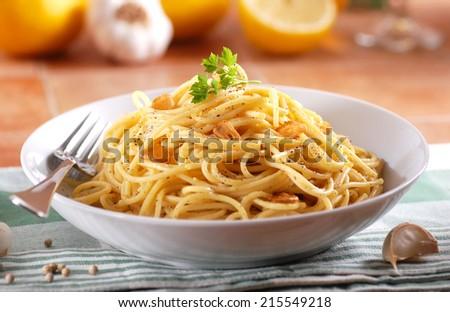 spaghetti with lemon, garlic and pepper - stock photo