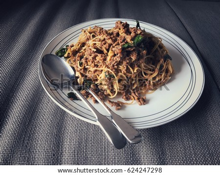 Spaghetti with meat source on dish on vintage filter