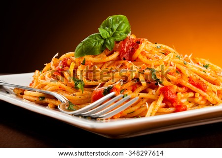 Spaghetti with meat, tomato sauce and vegetables  - stock photo