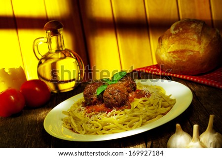 Spaghetti with meatballs, basil and red tomato sauce - stock photo