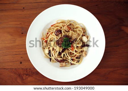 spaghetti with mushroom for vegan on wooded background - stock photo