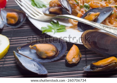 Spaghetti with Mussels in a homemade tomato sauce - stock photo