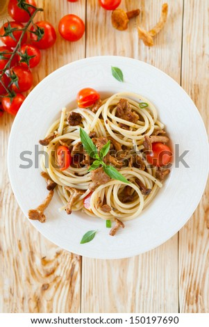spaghetti with pesto and cherry tomatoes, top view - stock photo