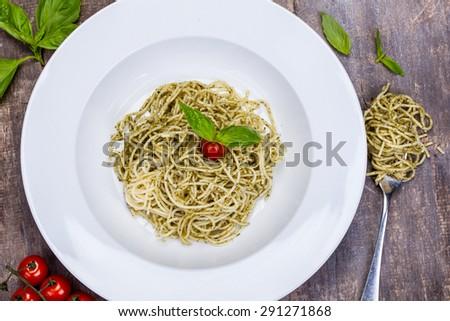 Spaghetti with pesto sauce - stock photo