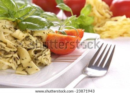 Spaghetti with pesto sauce and cheese