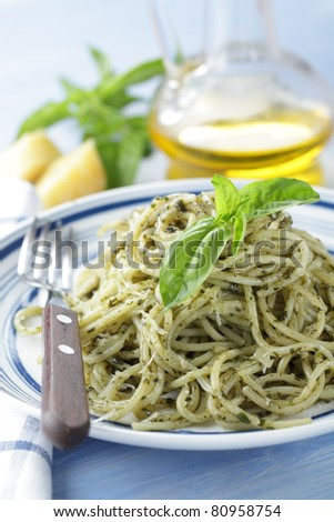 Spaghetti with pesto sauce, parmesan cheese and mint closeup - stock photo
