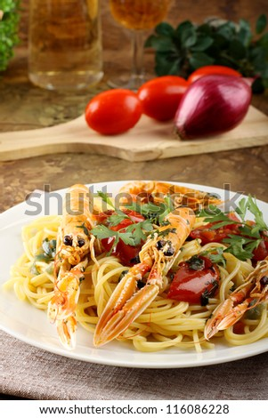Spaghetti with prawns on complex background - stock photo