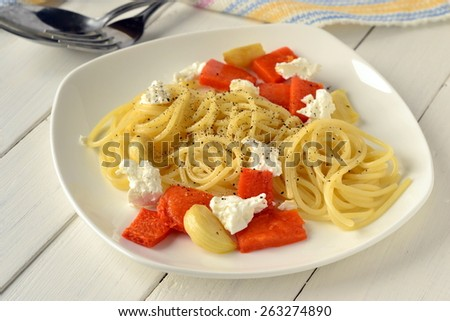 Spaghetti with roasted pumpkin and cottage cheese - stock photo