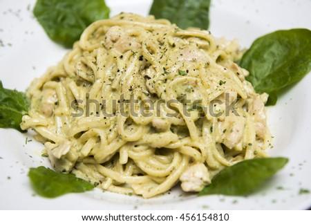 Spaghetti with salmon creamy sauce - stock photo