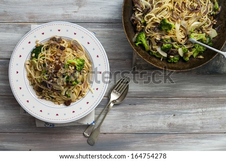 Spaghetti with sardines and broccoli - stock photo