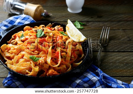 Spaghetti with seafood in a pan, mediterranean food - stock photo