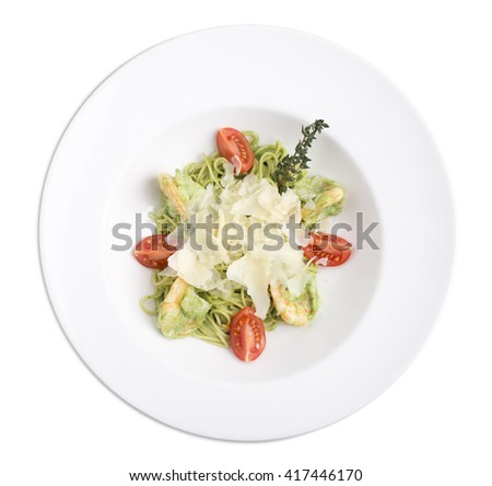 Spaghetti with shrimps and pesto covered with parmesan. Isolated on a white background. - stock photo