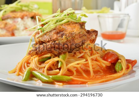 Spaghetti with soft shell crab in white dish.     - stock photo