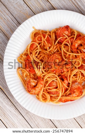 Spaghetti with spicy shrimps - stock photo