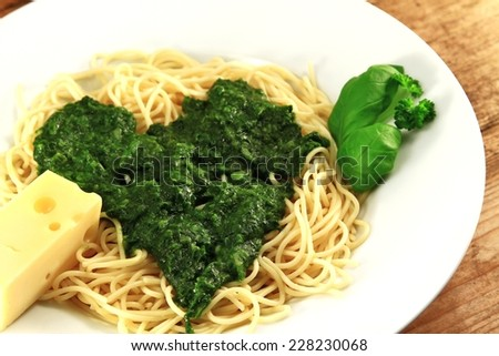 Spaghetti with spinach and cheese - stock photo