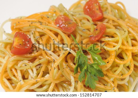 spaghetti with tomato and spices in olive oil