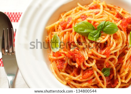 Spaghetti with tomato sauce and basil - stock photo