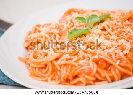 spaghetti with tomato sauce and cheese - stock photo