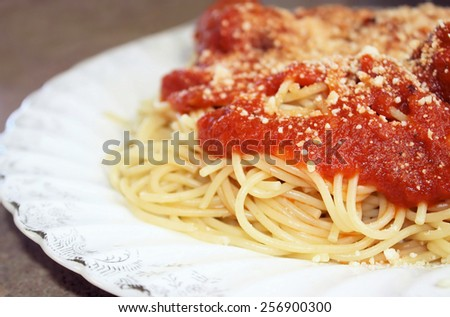 Spaghetti With Tomato Sauce And Grated Parmesan Cheese  - stock photo