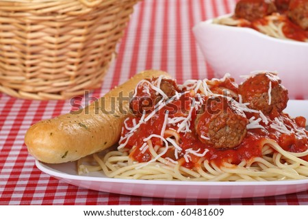 Spaghetti with tomato sauce and meatball meal with garlic bread stick - stock photo