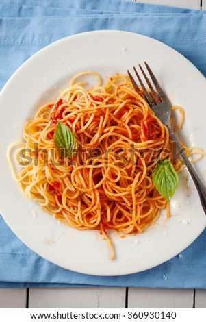 spaghetti with tomato sauce in plate - stock photo