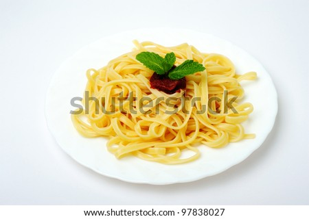 spaghetti with tomato sauce in white plate