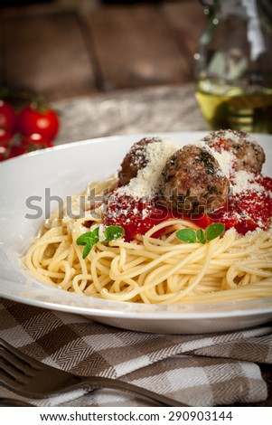 Spaghetti with tomato sauce ,meatballs  and grated parmesan