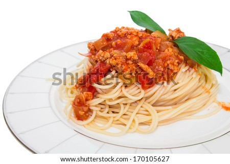 Spaghetti with tomato sauce on a plate isolated on white background.