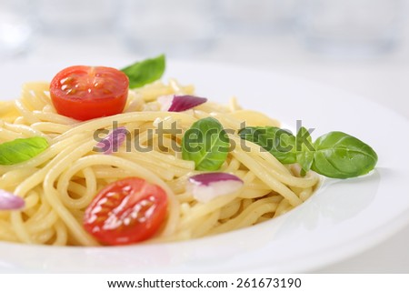 Spaghetti with tomatoes and basil noodles pasta on a plate - stock photo