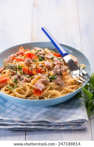 spaghetti with tuna capers and  tomatoes - stock photo