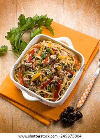 spaghetti with tuna capers olives and peppers - stock photo