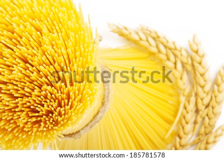 Spaghetti with wheat ears - stock photo