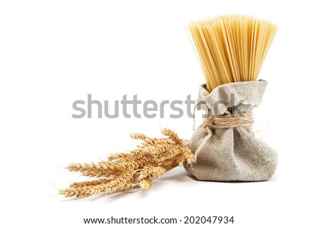 Spaghetti with wheat ears isolated on white background. - stock photo